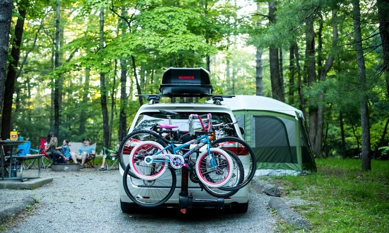 White minivan camping scene with Yakima Bike and Roof Rack