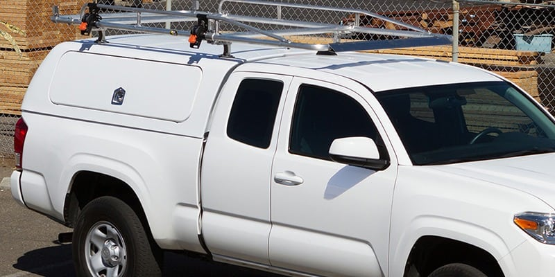 White work truck with custom rooftop cargo frame system