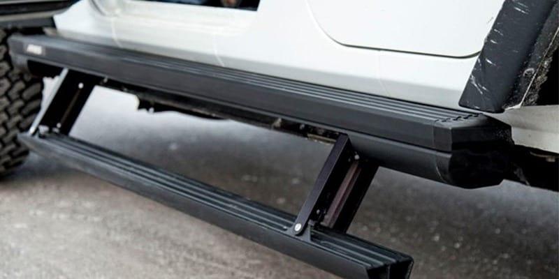 Aires step bar on white Jeep Wrangler