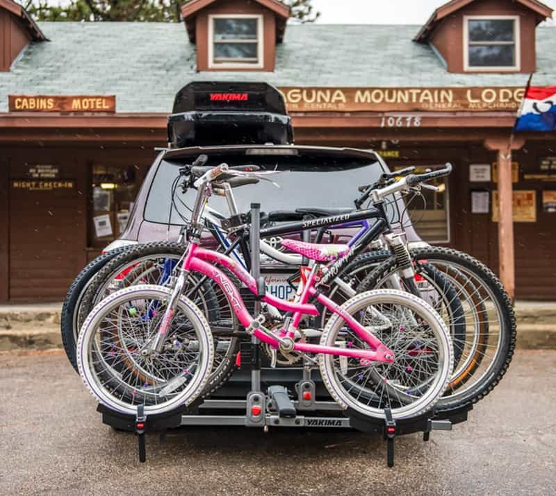 SUV parked at cabin with Yakima bike and roof rack