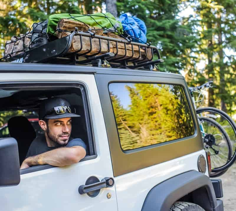 White Jeep Wrangler with Yakima Cargo Carrier and bike rack in trailer hitch